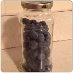 Use a repurposed jar to keep your berries fresh longer.