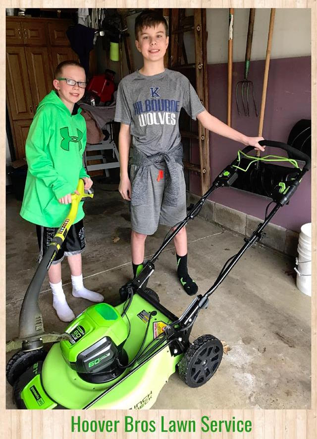 boys with lawn mower